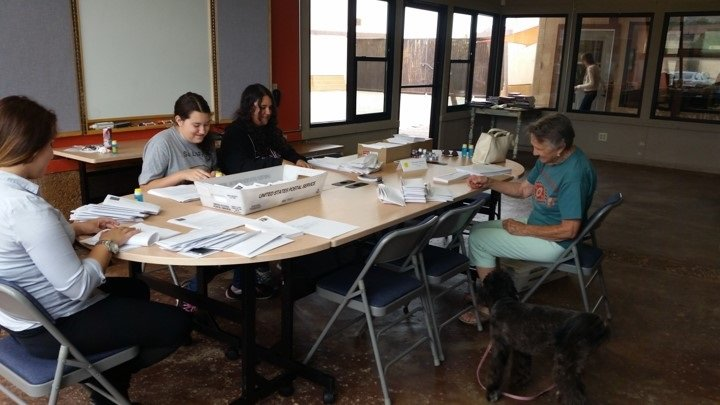 photo of volunteers stuffing envelopes for a mailing