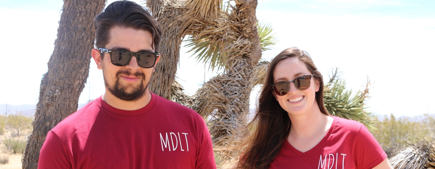 photo of two people wearing MDLT T-shirts