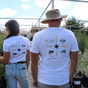 Photo of back of Bee Kind Shirts